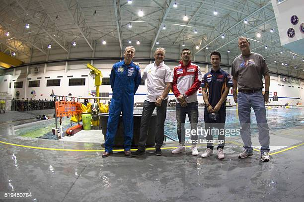 Kevin Schwanz of USA Andrea Iannone of Italy and Ducati Team and Dani Pedrosa of Spain and Repsol Honda Team pose in the pool with Nasa staff during...