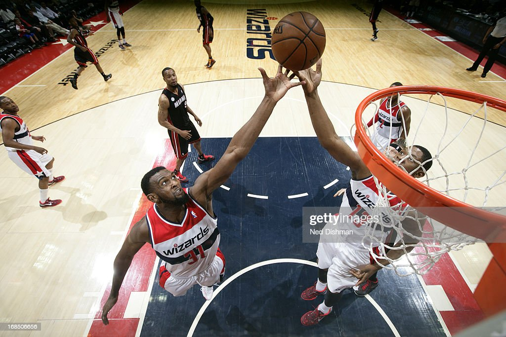 <a gi-track='captionPersonalityLinkClicked' href=/galleries/search?phrase=Kevin+Seraphin&family=editorial&specificpeople=6474998 ng-click='$event.stopPropagation()'>Kevin Seraphin</a> #13 and <a gi-track='captionPersonalityLinkClicked' href=/galleries/search?phrase=Chris+Singleton&family=editorial&specificpeople=241555 ng-click='$event.stopPropagation()'>Chris Singleton</a> #31 of the Washington Wizards go up for a rebound against the Miami Heat at the Verizon Center on April 10, 2013 in Washington, DC.