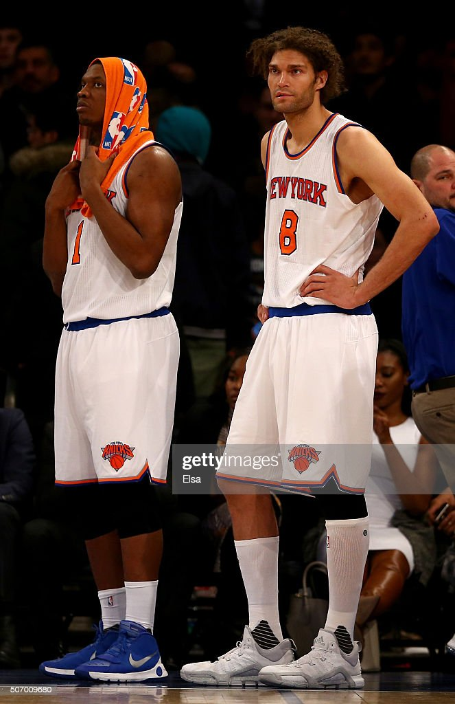 Kevin Seraphin and Robin Lopez of the New York Knicks react to the loss to the Oklahoma City Thunder at Madison Square Garden on January 26 2016 in...