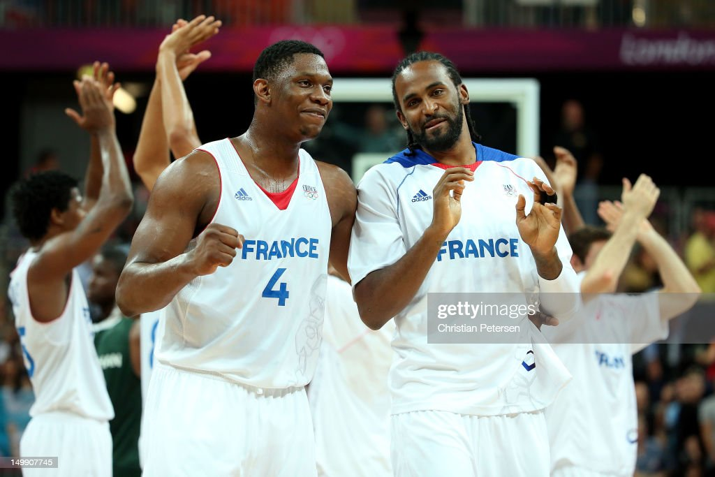 Kevin Seraphin #4 and Ronny Turiaf #14 of France celebrate after they won 79-73 against Nigeria during the Men's Basketball Preliminary Round match on Day 10 of the London 2012 Olympic Games at the Basketball Arena on August 6, 2012 in London, England.
