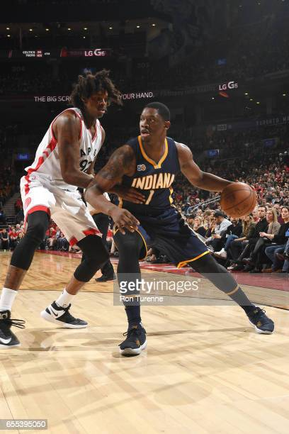 Kevin Seraphin of the Indiana Pacers handles the ball against Lucas Nogueira of the Toronto Raptors during the game on March 19 2017 at the Air...