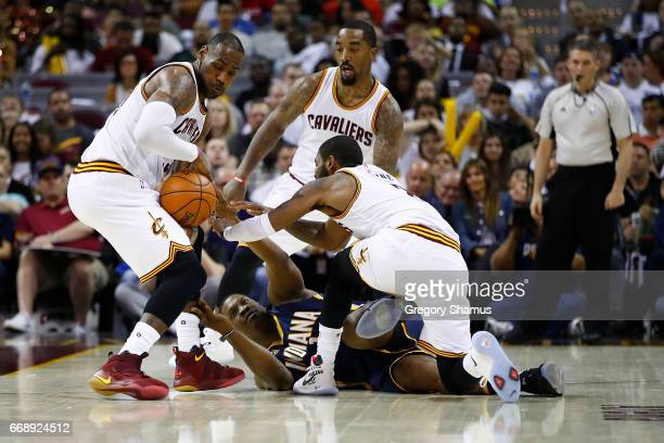 Kevin Seraphin of the Indiana Pacers loses the ball to LeBron James of the Cleveland Cavaliers during the second half in Game One of the Eastern...