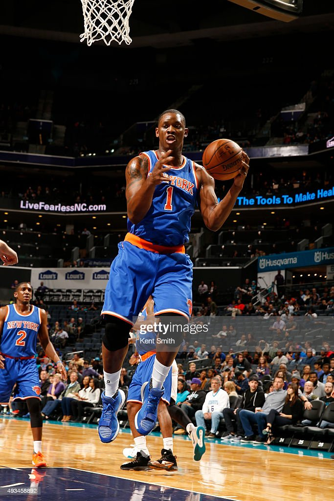 Kevin Seraphin #1 of the New York Knicks grabs a rebound against the Charlotte Hornets during a preseason game at the Time Warner Cable Arena on October 17, 2015 in Charlotte, North Carolina.