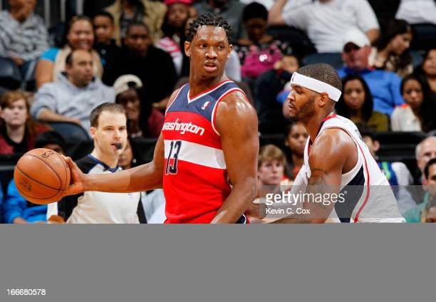 Kevin Seraphin of the Washington Wizards against Josh Smith of the Atlanta Hawks at Philips Arena on December 7 2012 in Atlanta Georgia NOTE TO USER...