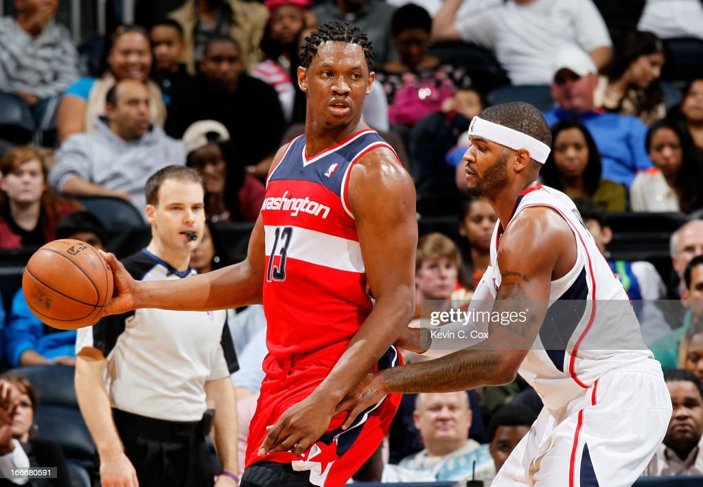<a gi-track='captionPersonalityLinkClicked' href=/galleries/search?phrase=Kevin+Seraphin&family=editorial&specificpeople=6474998 ng-click='$event.stopPropagation()'>Kevin Seraphin</a> #13 of the Washington Wizards against <a gi-track='captionPersonalityLinkClicked' href=/galleries/search?phrase=Josh+Smith+-+Basketball+Player+-+Born+1985&family=editorial&specificpeople=201983 ng-click='$event.stopPropagation()'>Josh Smith</a> #5 of the Atlanta Hawks at Philips Arena on December 7, 2012 in Atlanta, Georgia.