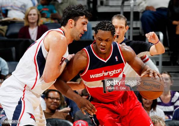 Kevin Seraphin of the Washington Wizards against Zaza Pachulia of the Atlanta Hawks at Philips Arena on December 7 2012 in Atlanta Georgia NOTE TO...