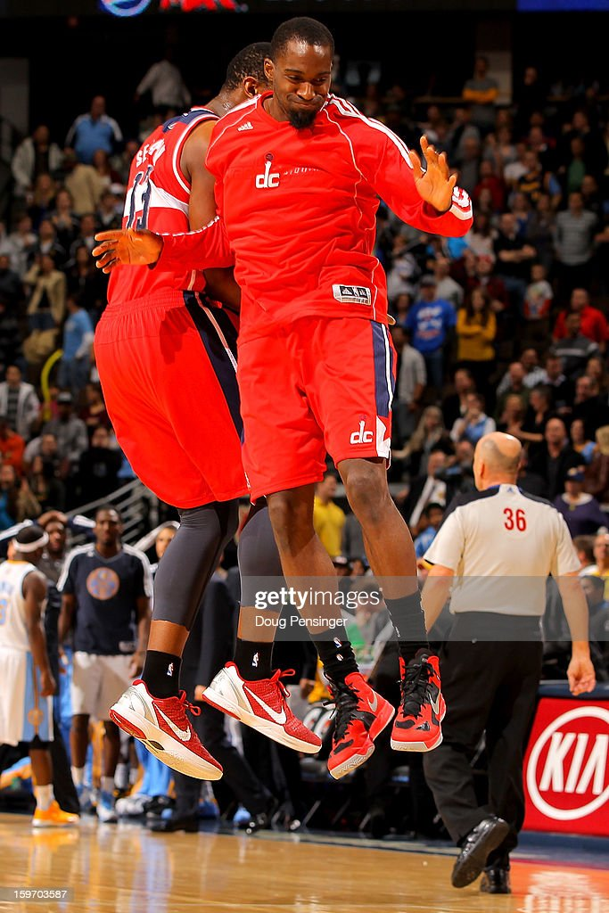 Kevin Seraphin #13 of the Washington Wizards and Martell Webster #9 of the Washington Wizards celebrate a play against the Denver Nuggets at the Pepsi Center on January 18, 2013 in Denver, Colorado. The Wizards defeated the Nuggets 112-108.