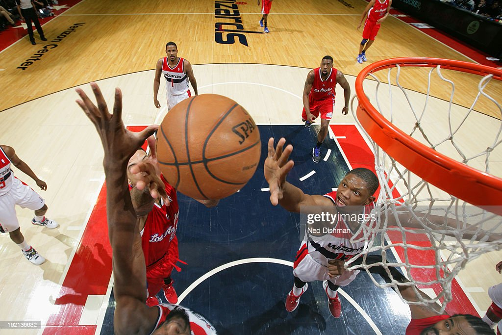 <a gi-track='captionPersonalityLinkClicked' href=/galleries/search?phrase=Kevin+Seraphin&family=editorial&specificpeople=6474998 ng-click='$event.stopPropagation()'>Kevin Seraphin</a> #13 of the Washington Wizards attempts to block a shot against the Los Angeles Clippers on February 4, 2013 at the Verizon Center in Washington, DC.