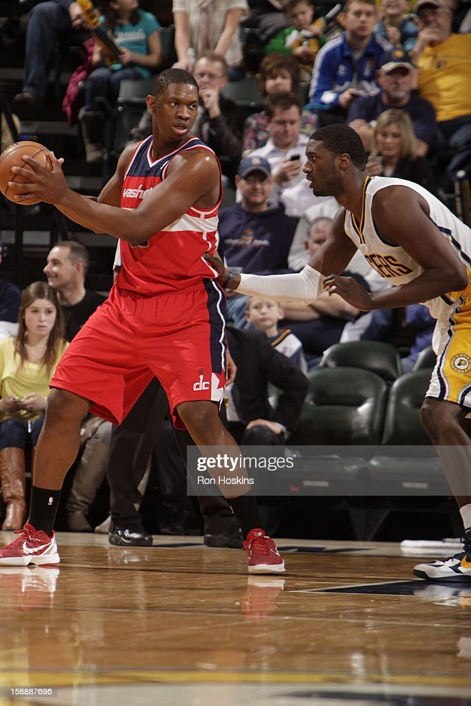 <a gi-track='captionPersonalityLinkClicked' href=/galleries/search?phrase=Kevin+Seraphin&family=editorial&specificpeople=6474998 ng-click='$event.stopPropagation()'>Kevin Seraphin</a> #13 of the Washington Wizards controls the ball against <a gi-track='captionPersonalityLinkClicked' href=/galleries/search?phrase=Roy+Hibbert&family=editorial&specificpeople=725128 ng-click='$event.stopPropagation()'>Roy Hibbert</a> #55 of the Indiana Pacers on January 2, 2013 at Bankers Life Fieldhouse in Indianapolis, Indiana.