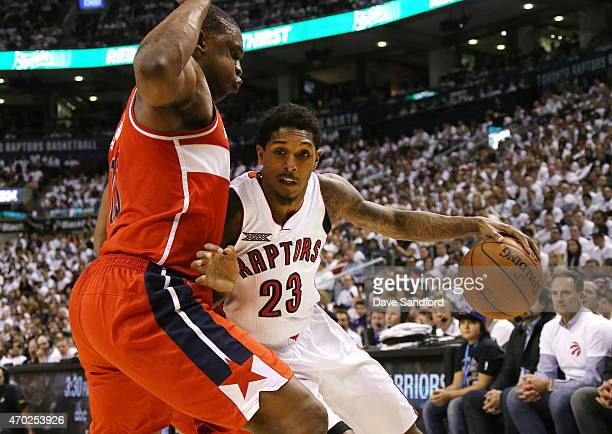 Kevin Seraphin of the Washington Wizards defends against Louis Williams of the Toronto Raptors as he drives to the basket during game one of their...