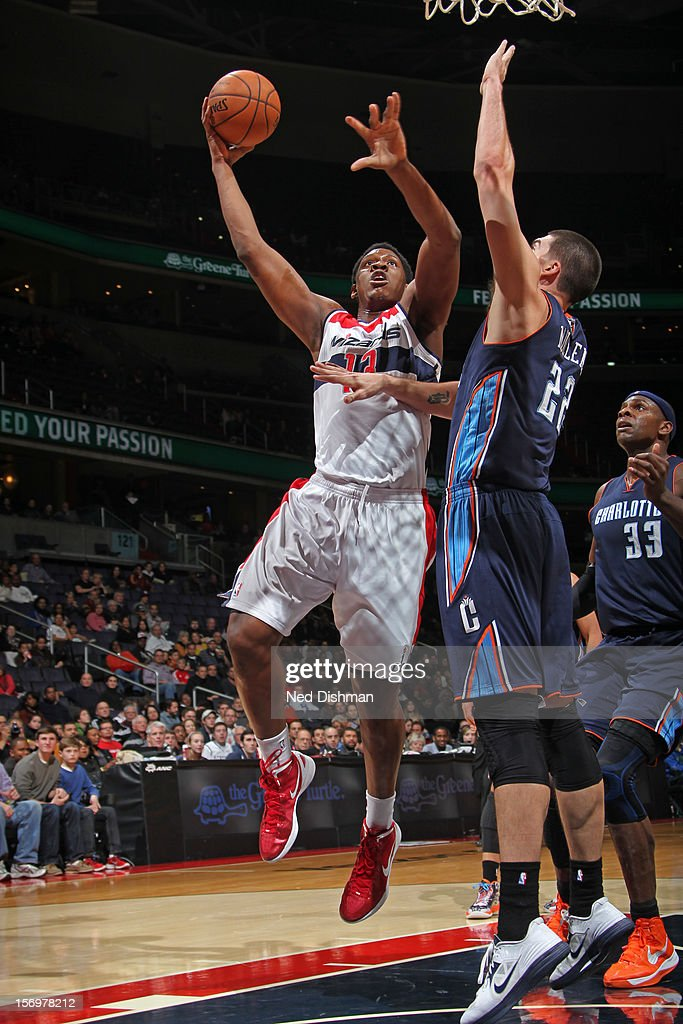 <a gi-track='captionPersonalityLinkClicked' href=/galleries/search?phrase=Kevin+Seraphin&family=editorial&specificpeople=6474998 ng-click='$event.stopPropagation()'>Kevin Seraphin</a> #13 of the Washington Wizards drives to the basket against Byron Mullens #22 of the Charlotte Bobcats during the game at the Verizon Center on November 24, 2012 in Washington, DC.
