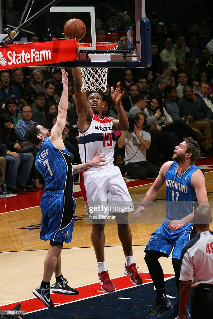 Kevin Seraphin #13 of the Washington Wizards drives to the basket against the Orlando Magic at the Verizon Center on December 28, 2012 in Washington, DC.