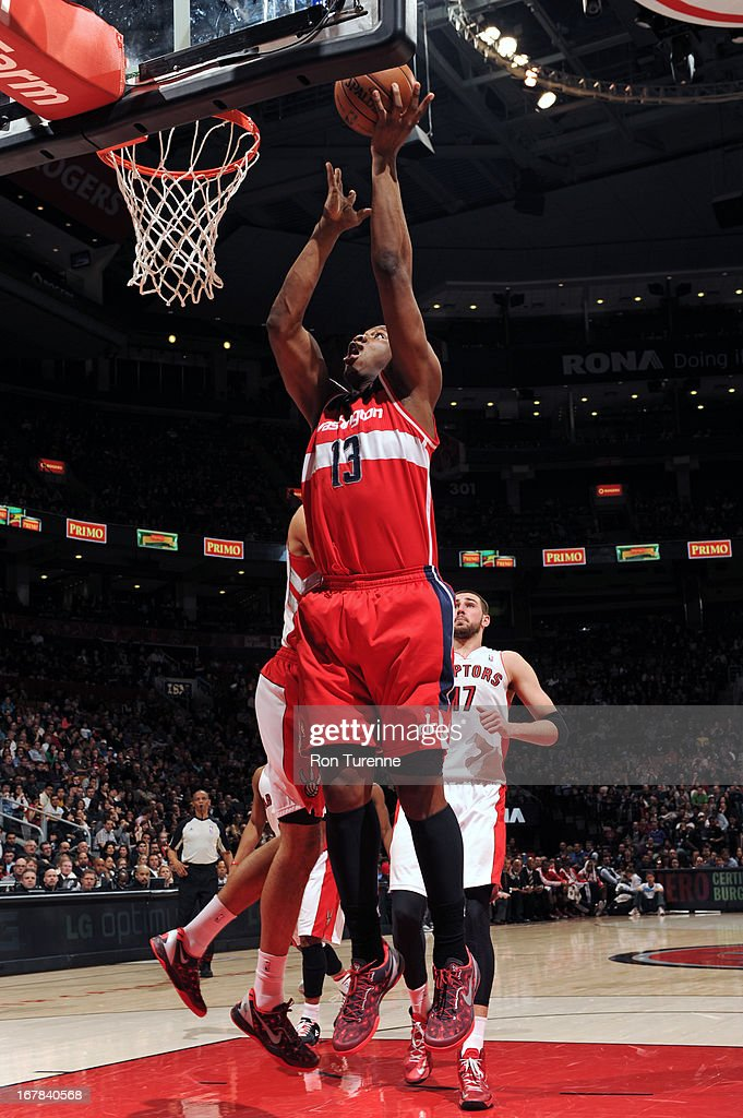 Kevin Seraphin #13 of the Washington Wizards drives to the basket against the Toronto Raptors on April 3, 2013 at the Air Canada Centre in Toronto, Ontario, Canada.