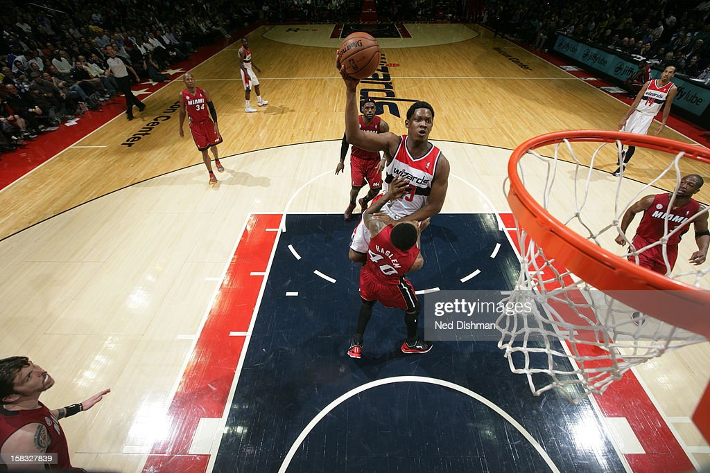 <a gi-track='captionPersonalityLinkClicked' href=/galleries/search?phrase=Kevin+Seraphin&family=editorial&specificpeople=6474998 ng-click='$event.stopPropagation()'>Kevin Seraphin</a> #13 of the Washington Wizards drives to the basket and puts up a shot over <a gi-track='captionPersonalityLinkClicked' href=/galleries/search?phrase=Udonis+Haslem&family=editorial&specificpeople=201748 ng-click='$event.stopPropagation()'>Udonis Haslem</a> #40 of the Miami Heat at the Verizon Center on December 4, 2012 in Washington, DC.