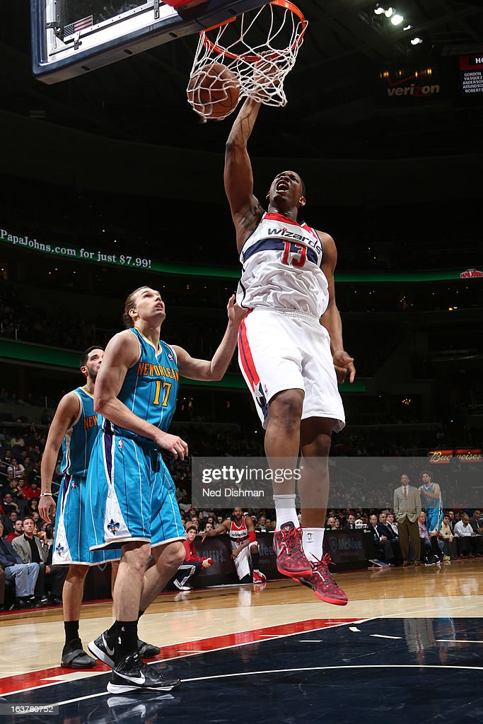 <a gi-track='captionPersonalityLinkClicked' href=/galleries/search?phrase=Kevin+Seraphin&family=editorial&specificpeople=6474998 ng-click='$event.stopPropagation()'>Kevin Seraphin</a> #13 of the Washington Wizards dunks against Lou Amundson #17 of the New Orleans Hornets during the game at the Verizon Center on March 15, 2013 in Washington, DC.