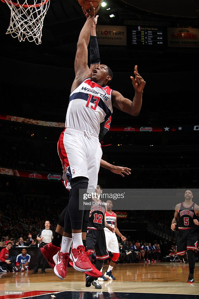 Kevin Seraphin #13 of the Washington Wizards dunks the ball against the Chicago Bulls at the Verizon Center on January 26, 2013 in Washington, DC.