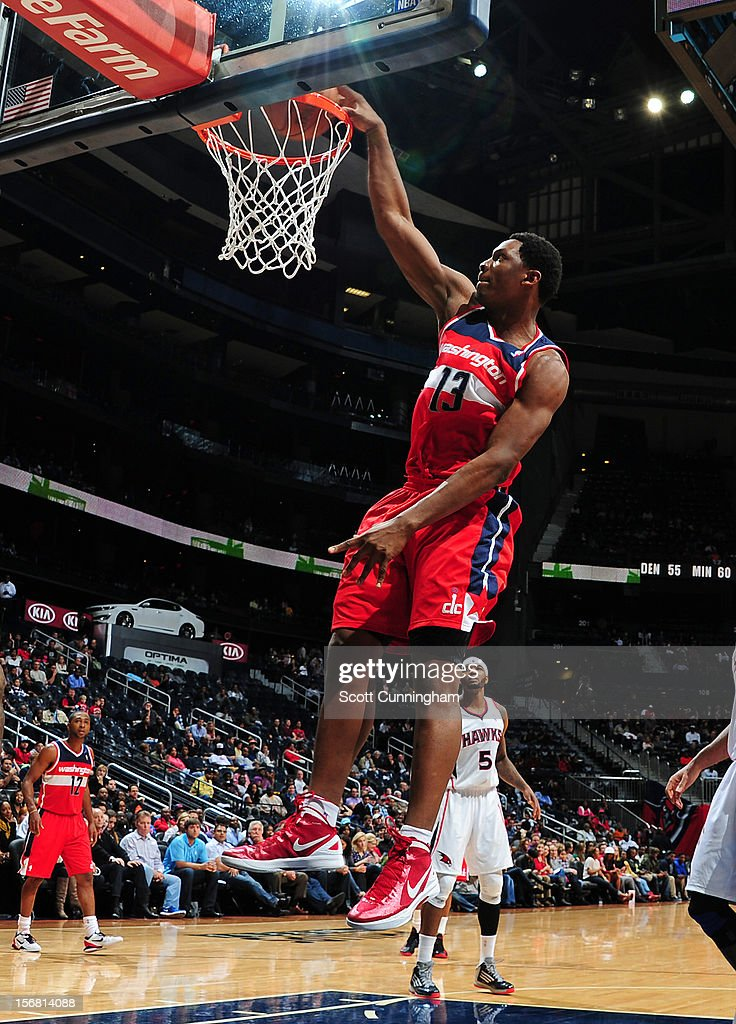 <a gi-track='captionPersonalityLinkClicked' href=/galleries/search?phrase=Kevin+Seraphin&family=editorial&specificpeople=6474998 ng-click='$event.stopPropagation()'>Kevin Seraphin</a> #13 of the Washington Wizards dunks the ball vs the Atlanta Hawks at Philips Arena on November 21, 2012 in Atlanta, Georgia.
