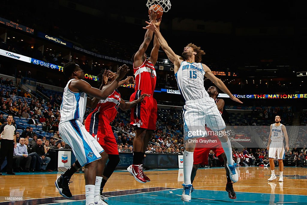 Kevin Seraphin #13 of the Washington Wizards fights for a rebound with Robin Lopez #15 of the New Orleans Hornets at New Orleans Arena on December 11, 2012 in New Orleans, Louisiana.