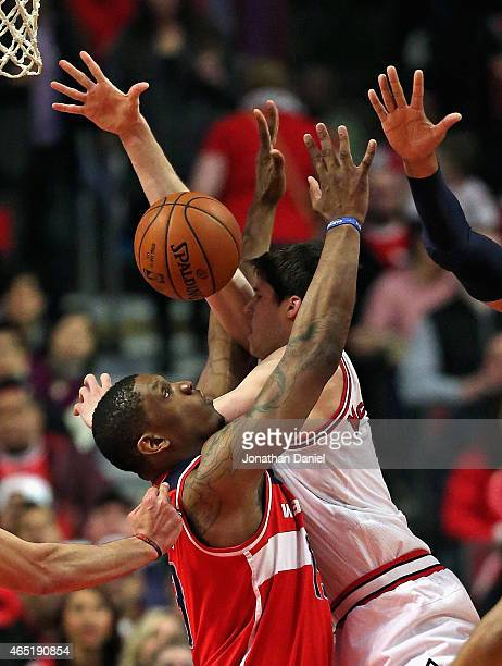 Kevin Seraphin of the Washington Wizards fouls Doug McDermott of the Chicago Bulls at the United Center on March 3 2015 in Chicago Illinois NOTE TO...
