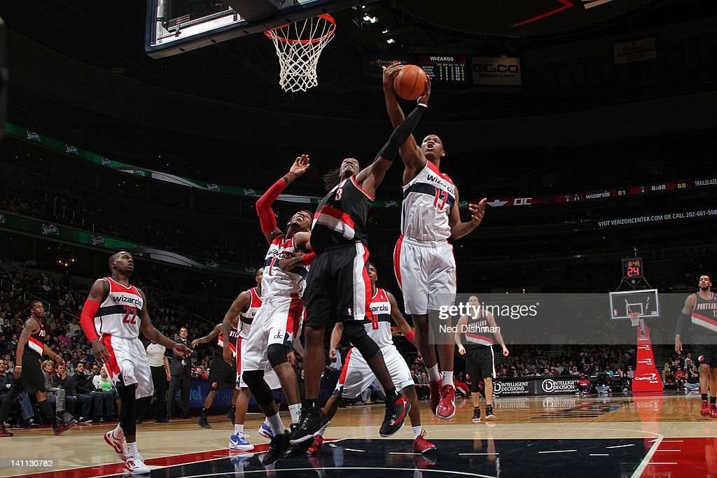 <a gi-track='captionPersonalityLinkClicked' href=/galleries/search?phrase=Kevin+Seraphin&family=editorial&specificpeople=6474998 ng-click='$event.stopPropagation()'>Kevin Seraphin</a> #13 of the Washington Wizards goes for the ball against <a gi-track='captionPersonalityLinkClicked' href=/galleries/search?phrase=Gerald+Wallace&family=editorial&specificpeople=202117 ng-click='$event.stopPropagation()'>Gerald Wallace</a> #3 of the Portland Trail Blazers at the Verizon Center on March 10, 2012 in Washington, DC.
