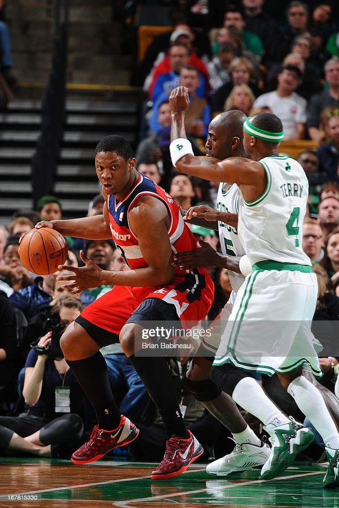 BOSTON, MA - APRIL 7 <a gi-track='captionPersonalityLinkClicked' href=/galleries/search?phrase=Kevin+Seraphin&family=editorial&specificpeople=6474998 ng-click='$event.stopPropagation()'>Kevin Seraphin</a> #13 of the Washington Wizards is defended by <a gi-track='captionPersonalityLinkClicked' href=/galleries/search?phrase=Kevin+Garnett&family=editorial&specificpeople=201473 ng-click='$event.stopPropagation()'>Kevin Garnett</a> #5 and <a gi-track='captionPersonalityLinkClicked' href=/galleries/search?phrase=Jason+Terry&family=editorial&specificpeople=201734 ng-click='$event.stopPropagation()'>Jason Terry</a> #4 of the Boston Celtics on April 7, 2013 at the TD Garden in Boston, Massachusetts.