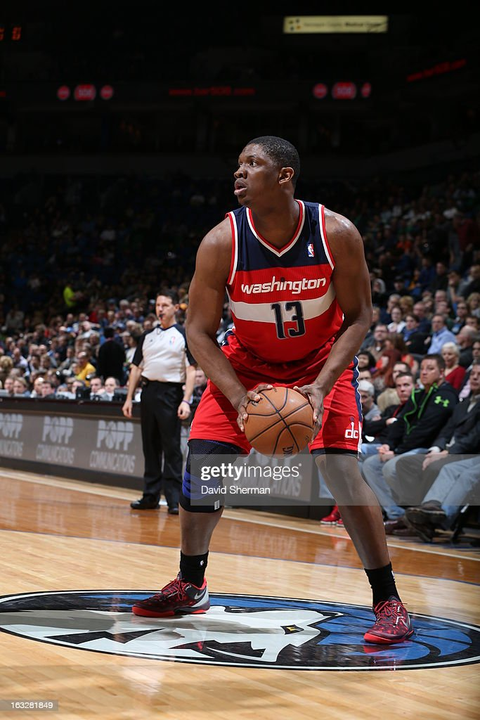 Kevin Seraphin #13 of the Washington Wizards looks to shoot the ball against the Minnesota Timberwolves on March 6, 2013 at Target Center in Minneapolis, Minnesota.