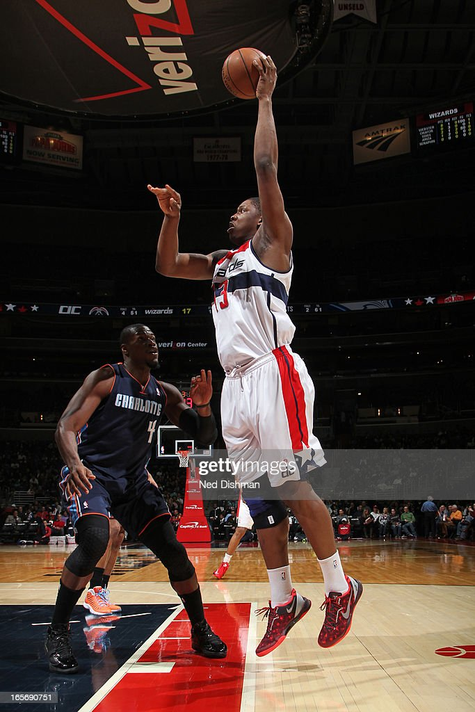 Kevin Seraphin #13 of the Washington Wizards puts up a shot against the Charlotte Bobcats at the Verizon Center on March 9, 2013 in Washington, DC.
