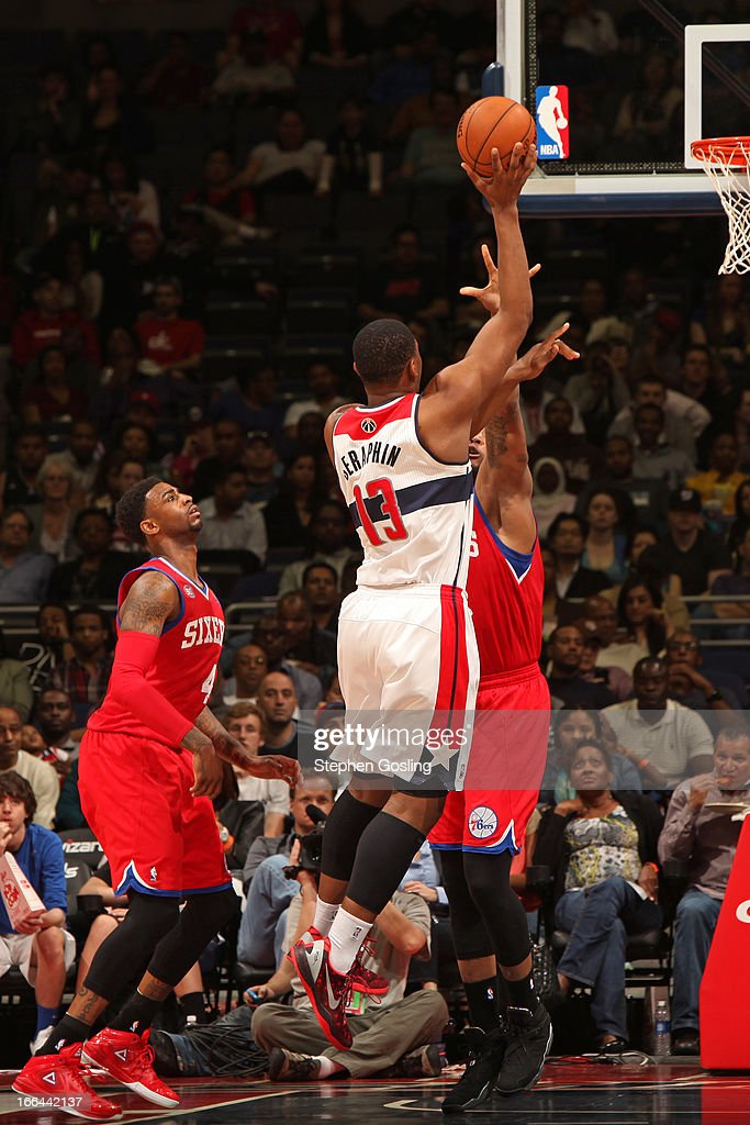 <a gi-track='captionPersonalityLinkClicked' href=/galleries/search?phrase=Kevin+Seraphin&family=editorial&specificpeople=6474998 ng-click='$event.stopPropagation()'>Kevin Seraphin</a> #13 of the Washington Wizards puts up a shot against the Philadelphia 76ers at the Verizon Center on April 12, 2013 in Washington, DC.