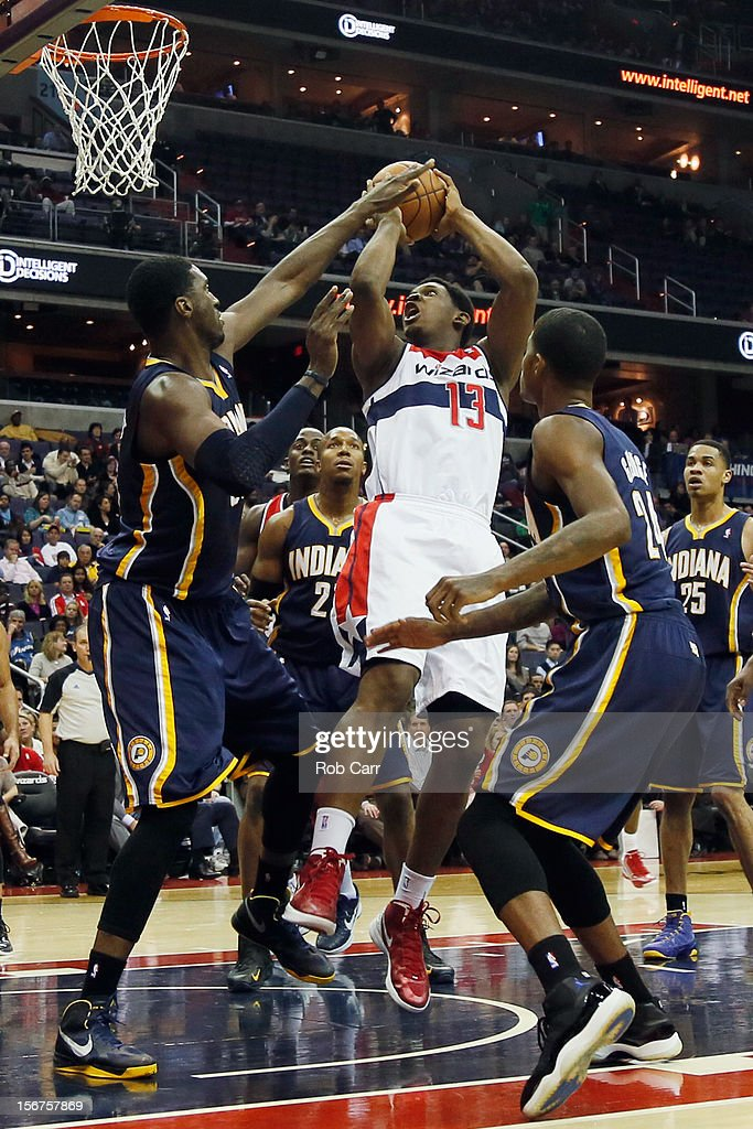 Kevin Seraphin #13 of the Washington Wizards puts up a shot in front of Roy Hibbert #55 (L) and Paul George #24 (R) of the Indiana Pacers during the first half at Verizon Center on November 19, 2012 in Washington, DC.