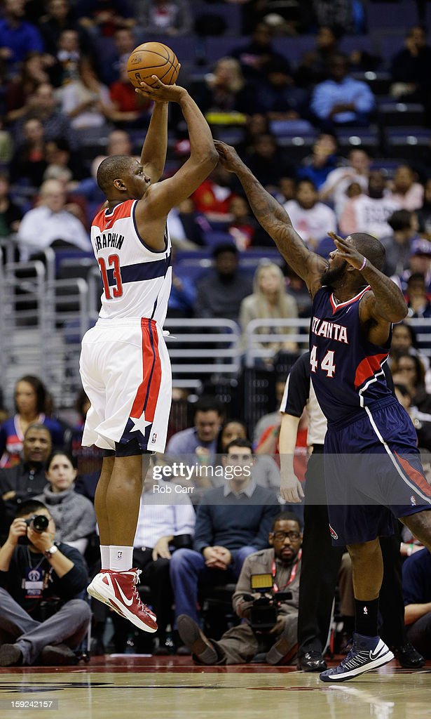 <a gi-track='captionPersonalityLinkClicked' href=/galleries/search?phrase=Kevin+Seraphin&family=editorial&specificpeople=6474998 ng-click='$event.stopPropagation()'>Kevin Seraphin</a> #13 of the Washington Wizards puts up a shot over Ivan Johnson #44 of the Atlanta Hawks at Verizon Center on December 18, 2012 in Washington, DC.