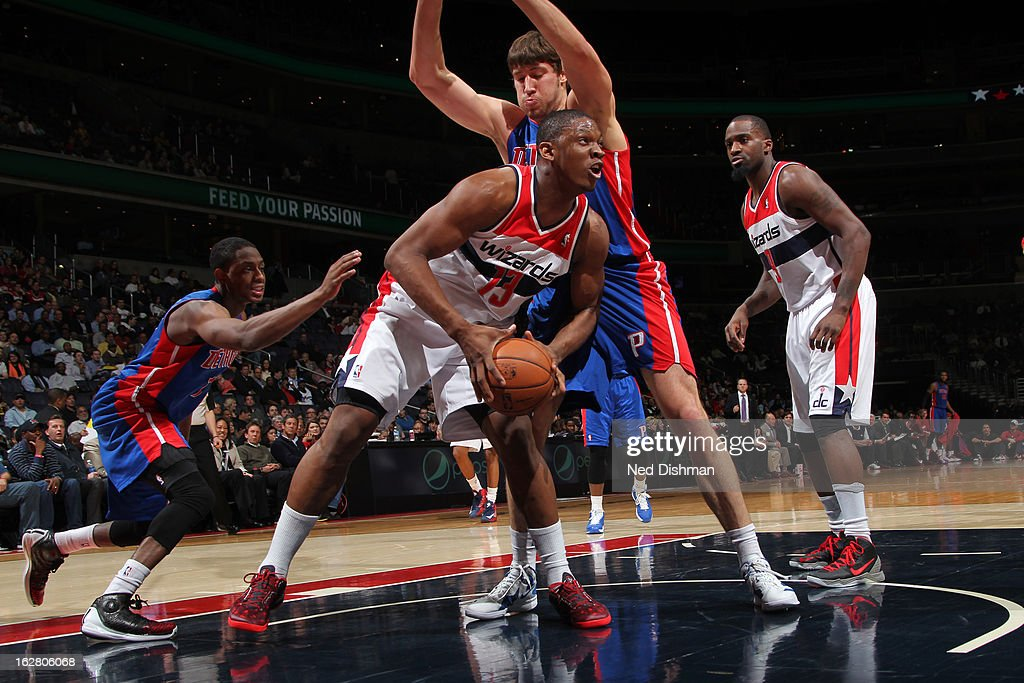 Kevin Seraphin of the Washington Wizards rebounds against Viacheslav Kravtsov of the Detroit Pistons during the game at the Verizon Center on...