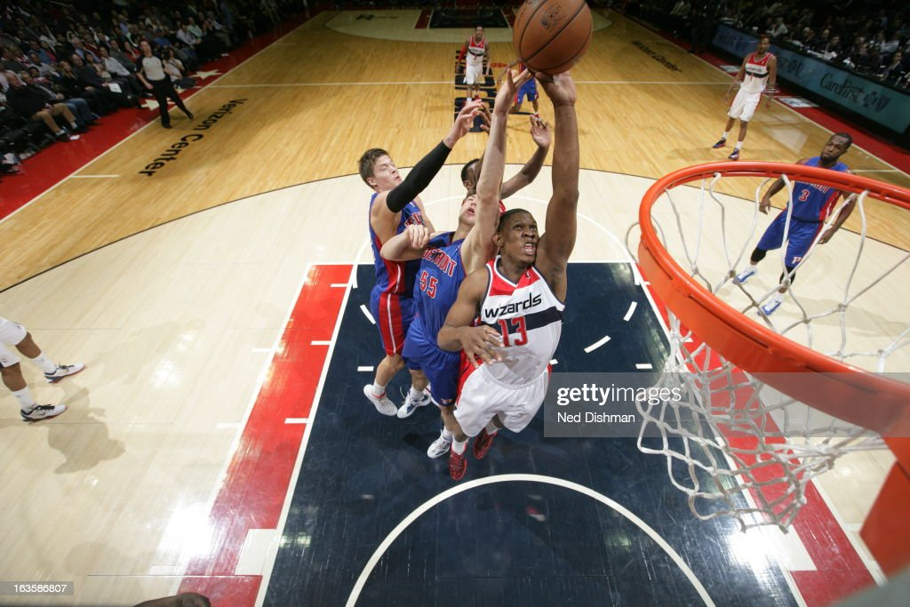 Kevin Seraphin of the Washington Wizards rebounds against Viacheslav Kravtsov and Jonas Jerebko of the Detroit Pistons at the Verizon Center on...