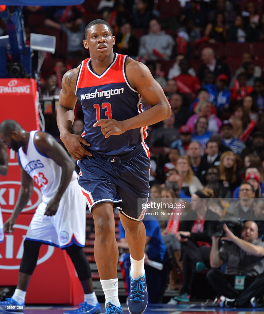 Kevin Seraphin #13 of the Washington Wizards runs up the court against the Philadelphia 76ers at Wells Fargo Center on April 8, 2015 in Philadelphia, Pennsylvania