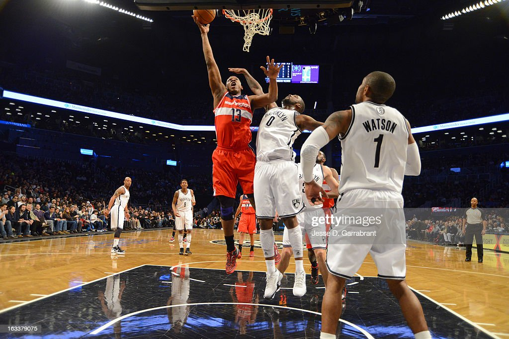 <a gi-track='captionPersonalityLinkClicked' href=/galleries/search?phrase=Kevin+Seraphin&family=editorial&specificpeople=6474998 ng-click='$event.stopPropagation()'>Kevin Seraphin</a> #13 of the Washington Wizards shoots a layup against <a gi-track='captionPersonalityLinkClicked' href=/galleries/search?phrase=Andray+Blatche&family=editorial&specificpeople=4282797 ng-click='$event.stopPropagation()'>Andray Blatche</a> #0 of the Brooklyn Nets on March 8, 2013 at the Barclays Center in Brooklyn, New York.