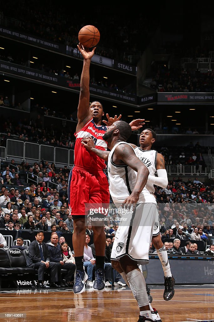 Kevin Seraphin #13 of the Washington Wizards shoots against Andray Blatche #0 of the Brooklyn Nets on April 15, 2013 at the Barclays Center in the Brooklyn borough of New York City.