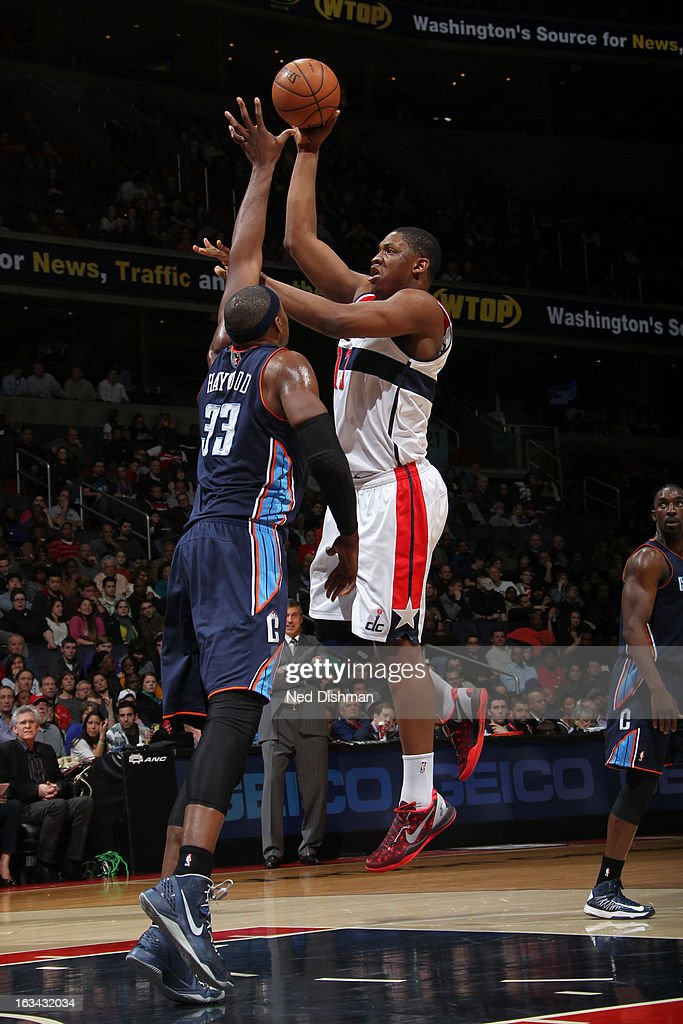 Kevin Seraphin #13 of the Washington Wizards shoots against Brendan Haywood #33 of the Charlotte Bobcats during the game at the Verizon Center on March 9, 2013 in Washington, DC.