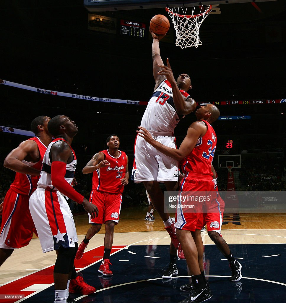 <a gi-track='captionPersonalityLinkClicked' href=/galleries/search?phrase=Kevin+Seraphin&family=editorial&specificpeople=6474998 ng-click='$event.stopPropagation()'>Kevin Seraphin</a> #13 of the Washington Wizards shoots against <a gi-track='captionPersonalityLinkClicked' href=/galleries/search?phrase=Brian+Cook+-+Basketball+Player&family=editorial&specificpeople=202839 ng-click='$event.stopPropagation()'>Brian Cook</a> #34 of the Los Angeles Clippers during the game at the Verizon Center on February 4, 2012 in Washington, DC.