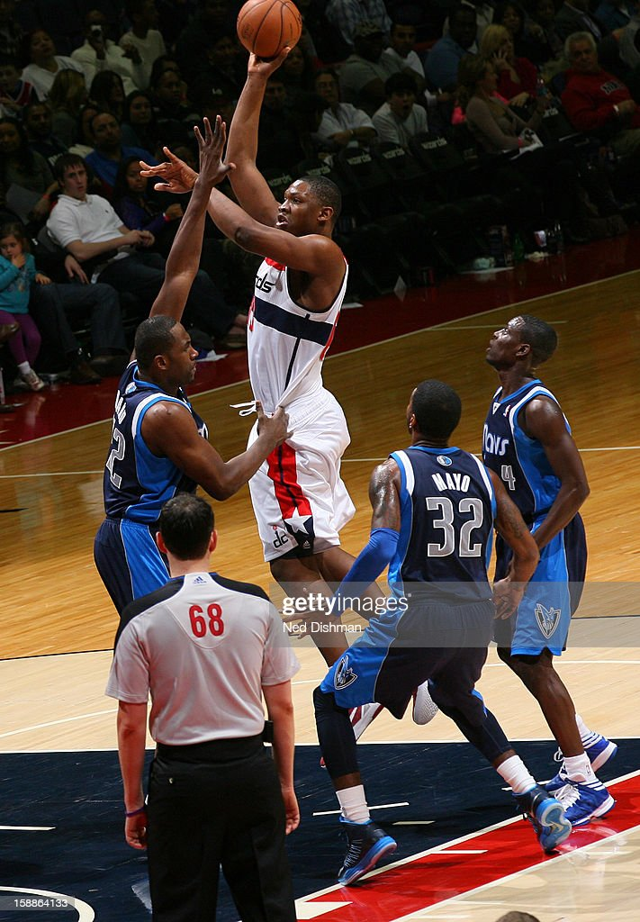 <a gi-track='captionPersonalityLinkClicked' href=/galleries/search?phrase=Kevin+Seraphin&family=editorial&specificpeople=6474998 ng-click='$event.stopPropagation()'>Kevin Seraphin</a> #13 of the Washington Wizards shoots against <a gi-track='captionPersonalityLinkClicked' href=/galleries/search?phrase=Elton+Brand&family=editorial&specificpeople=201501 ng-click='$event.stopPropagation()'>Elton Brand</a> #42 of the Dallas Mavericks during the game at the Verizon Center on January 1, 2013 in Washington, DC.