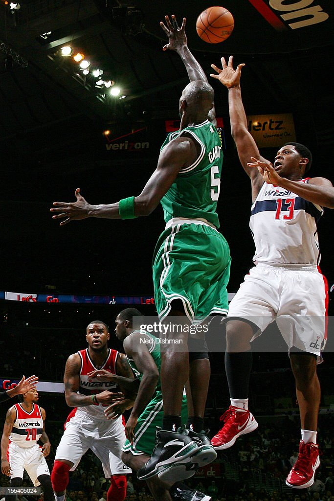 Kevin Seraphin #13 of the Washington Wizards shoots against Kevin Garnett #5 of the Boston Celtics during the game at the Verizon Center on November 3, 2012 in Washington, DC.