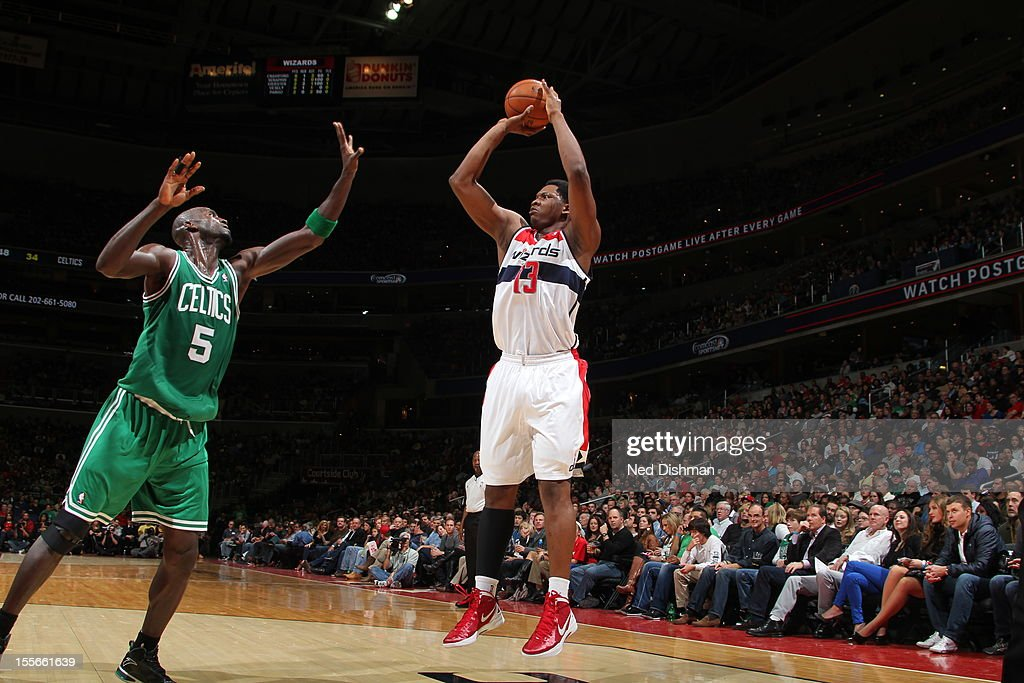 Kevin Seraphin #13 of the Washington Wizards shoots against Kevin Garnett #5 of the Boston Celtics at the Verizon Center on November 3, 2012 in Washington, DC.