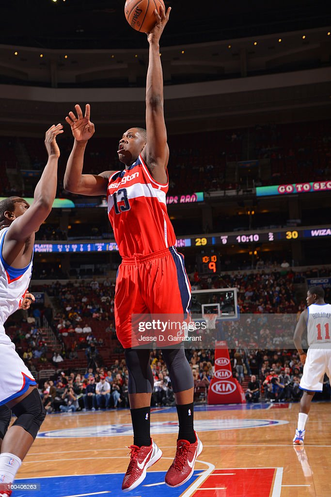 Kevin Seraphin #13 of the Washington Wizards shoots against the Philadelphia 76ers at the Wells Fargo Center on January 30, 2013 in Philadelphia, Pennsylvania.
