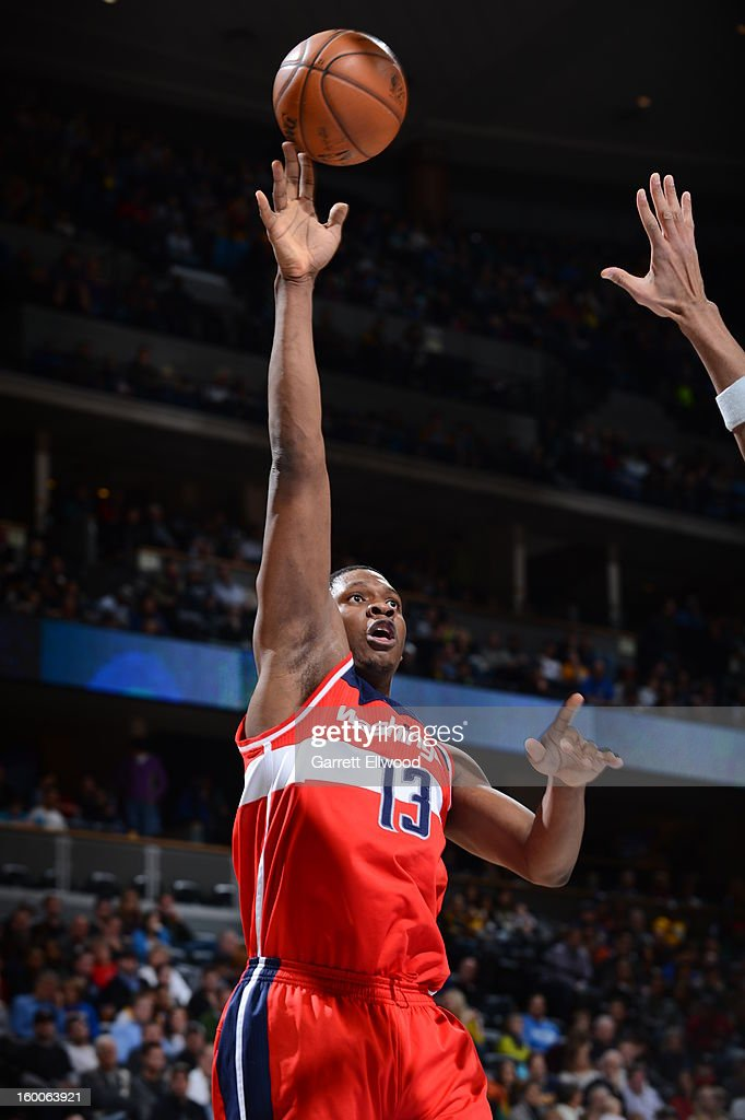<a gi-track='captionPersonalityLinkClicked' href=/galleries/search?phrase=Kevin+Seraphin&family=editorial&specificpeople=6474998 ng-click='$event.stopPropagation()'>Kevin Seraphin</a> #13 of the Washington Wizards shoots against the Denver Nuggets on January 18, 2013 at the Pepsi Center in Denver, Colorado.
