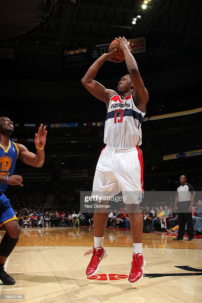 <a gi-track='captionPersonalityLinkClicked' href=/galleries/search?phrase=Kevin+Seraphin&family=editorial&specificpeople=6474998 ng-click='$event.stopPropagation()'>Kevin Seraphin</a> #13 of the Washington Wizards shoots against the Golden State Warriors on December 8, 2012 at the Verizon Center in Washington, DC.