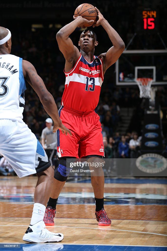 Kevin Seraphin #13 of the Washington Wizards shoots against the Minnesota Timberwolves on March 6, 2013 at Target Center in Minneapolis, Minnesota.