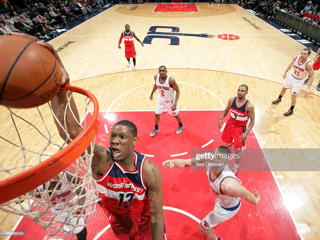 Kevin Seraphin #13 of the Washington Wizards shoots against the New York Knicks at the Verizon Center on April 3, 2015 in Washington, DC.