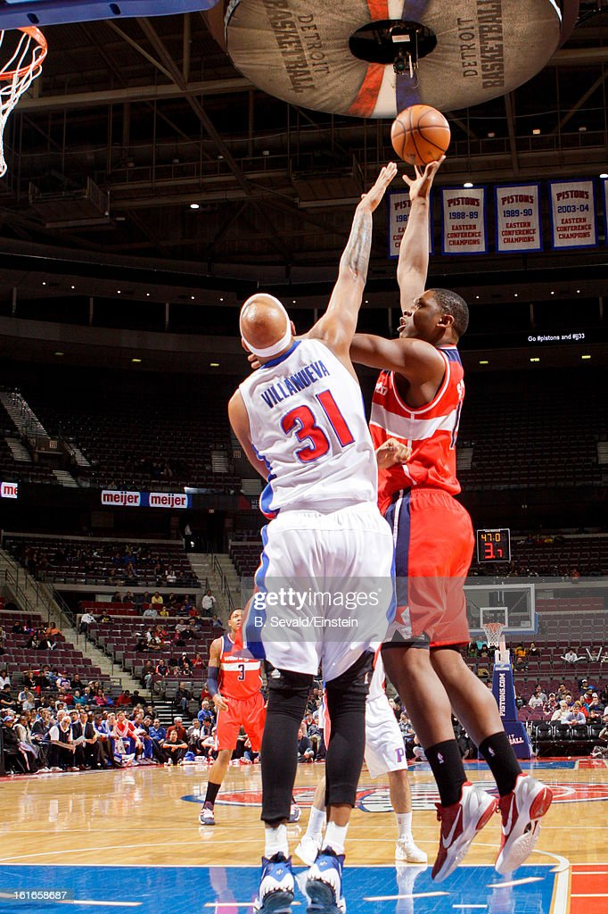 Kevin Seraphin #13 of the Washington Wizards shoots in the lane against Charlie Villanueva #31 of the Detroit Pistons on February 13, 2013 at The Palace of Auburn Hills in Auburn Hills, Michigan.
