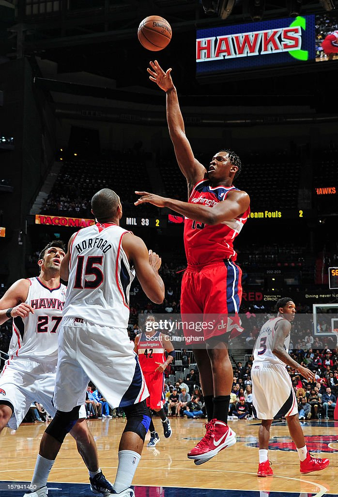 <a gi-track='captionPersonalityLinkClicked' href=/galleries/search?phrase=Kevin+Seraphin&family=editorial&specificpeople=6474998 ng-click='$event.stopPropagation()'>Kevin Seraphin</a> #13 of the Washington Wizards shoots over the Atlanta Hawks at Philips Arena on December , 2012 in Atlanta, Georgia.
