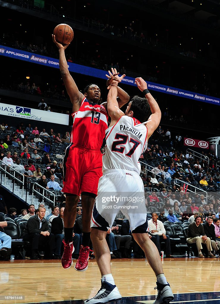 <a gi-track='captionPersonalityLinkClicked' href=/galleries/search?phrase=Kevin+Seraphin&family=editorial&specificpeople=6474998 ng-click='$event.stopPropagation()'>Kevin Seraphin</a> #13 of the Washington Wizards shoots over <a gi-track='captionPersonalityLinkClicked' href=/galleries/search?phrase=Zaza+Pachulia&family=editorial&specificpeople=202939 ng-click='$event.stopPropagation()'>Zaza Pachulia</a> #27 of the Atlanta Hawks at Philips Arena on December , 2012 in Atlanta, Georgia.