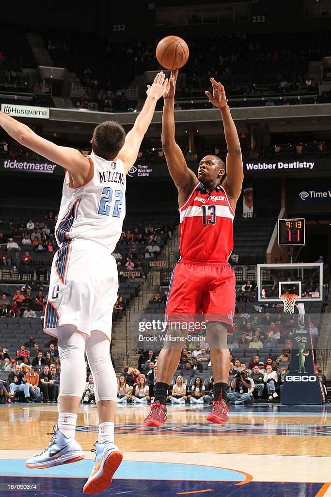 <a gi-track='captionPersonalityLinkClicked' href=/galleries/search?phrase=Kevin+Seraphin&family=editorial&specificpeople=6474998 ng-click='$event.stopPropagation()'>Kevin Seraphin</a> #13 of the Washington Wizards shoots the ball against Byron Mullens #22 of the Charlotte Bobcats at the Time Warner Cable Arena on March 18, 2013 in Charlotte, North Carolina.
