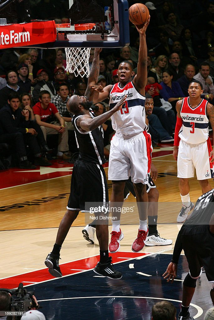 <a gi-track='captionPersonalityLinkClicked' href=/galleries/search?phrase=Kevin+Seraphin&family=editorial&specificpeople=6474998 ng-click='$event.stopPropagation()'>Kevin Seraphin</a> #13 of the Washington Wizards shoots the ball against the Brooklyn Nets on January 4, 2013 at the Verizon Center in Washington, DC.
